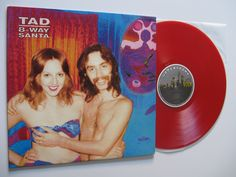 "Tad ""8-way santa"", '91 with the orig cover. Recorded by Butch Vig.   A friend of the band found this pic in a photo album at a a garage sale. They did not know who this two were and they had no permission. They modified colors to give the acid look (title is slang for blotter LSD). The man in the pic found out about the cover, and he thought it was cool. But the woman, who had become a Christian singer, did not.  So Tad and Sub Pop got sued and they had to change the cover and pay some cash."