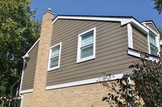 James Hardie Siding: Timber Bark, James Hardie Trim: Arctic White Installed in Naperville, IL by Opal Enterprises, Inc.