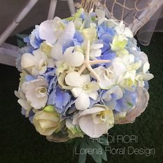 A soft blue bouquet with hydrangea, roses, starfishes and shells.
