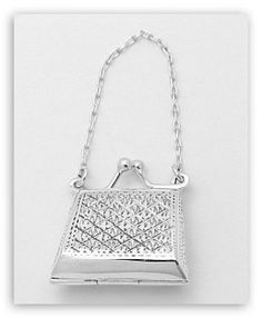 A purse-shaped sterling silver pill box!  So cute--and who would have thought to make one out of silver instead of the usual cheapo plastic ones at the drugstore?