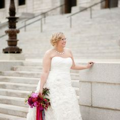 Strapless sweetheart gown and vibrant bouquet | L. Frisch Photography | www.theknot.com