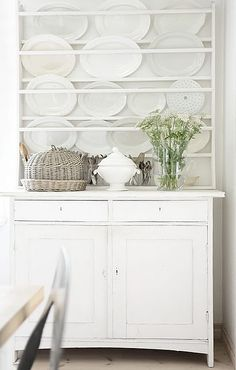 Love the wicker cloche and all that beautiful ironstone!