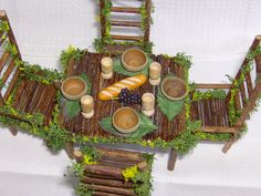 Acorn bowls & hand carved goblets, twig table and chairs ********************************************* iona.tasker via Flickr #fairy #garden #miniatures #furniture #table