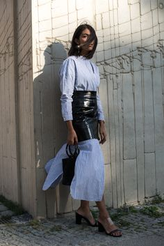 storm wears simon miller bag with maison scotch dress and a black leather skirt