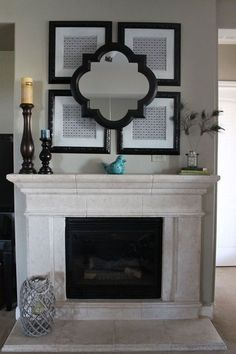 Black spray painted frames above the fireplace hold scrapbook paper in a pattern Frieling loves. For a 3-D effect, she installed the mirror with L brackets.