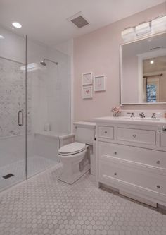 Hex Floor Tiles White Cabinet With Gl S And Pale Pink Walls Create A Timeless Feel To This Small Bathroom Brandon Architects Inc