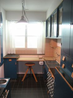 The Frankfurt Kitchen (shown here in replica) , designed by Margarete Schütte-Lihotzky in 1926, where reduced space meant increased efficiency, and was key to the kitchen's transformation into a rationalized modern domestic laboratory.