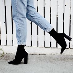 A black pointed toe stretch above ankle boot with a block woodstack heel. - Synthetic Upper and Synthetic Lining - Leg Height: 18cm Heel Height: 10.5cm