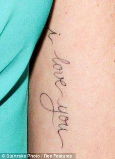 I love you tattoo written by husband. Perhaps on my hip or rib cage.... Places only he sees :)