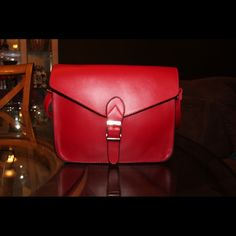 HOT RED CROSSBODY HANDBAG This Hot Red handbag will go with everything.  The faux leather makes it lightweight and easy to carry. A great get up and go bag. JSB Bags Crossbody Bags