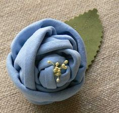 I made this little rose from scraps left over from another project .  The fabric is knit jersey...
