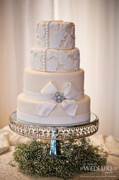 Cream & Lace Wedding Cake. My question is...how do you go about eating it? Is it edible or do you have to rip the cake apart before eating it??