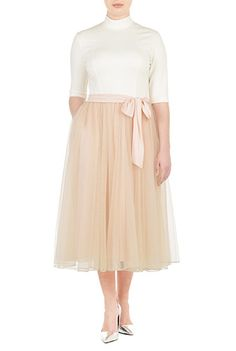 I would choose a different neckline -- maybe a high square or a scoop.  I <3 this Turtleneck ponte and tulle dress from eShakti