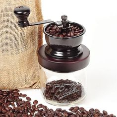 Metal/wood/ceramic coffee grinder. Fits mason jars. I think I would use this for herbs...hmmm