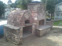 Beautiful Outdoor pizza oven, Outdoor Fireplace, and Barbeque grill with flagstone countertops built by masterpiece masonry 314 954 8269