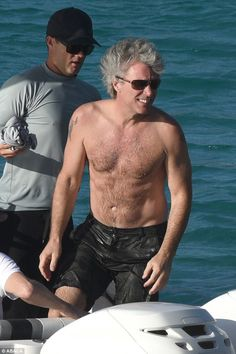 Bod Jovi! Shirtless Jon Bon Jovi showed off his impressive physique on Sunday