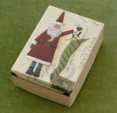 This is a great way to recycle old Christmas Cards and make a beautiful gift box for free!