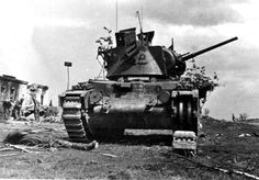 Lend-Lease. Knocked out British production Matilda in Soviet service. On the left in the background are Germans soldiers of the 19th Armored Division