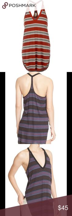 Brand New Free People Louie Striped Tunic Color is Depicted in First Pic 🌹Super soft ribbed tunic tank featuring a striped pattern. Rounded high low hem and V-neck with a thin racerback.  We The Free  FP EXCLUSIVE :Only sold thru Free People. One of nine exclusive, in-house labels. Perfectly distressed, all-American styles.  66% Rayon 31% Polyester 3% Spandex Machine Wash Cold Import Free People Tops Tunics