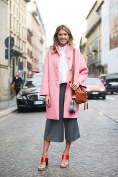 BloggerHelena Bordon wears a Prada coatand Fendi bag during Milan Fashion Week.
