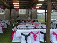 Black and hot pink sashes on the chair covers, about easier looking and D.I.Y.