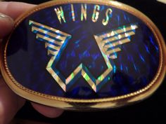 Your place to buy and sell all things handmade Paul Mccartney And Wings, Wings Logo, Volkswagen Logo, Blue Backgrounds, Rock Music, Beatles, Belt Buckles, Overlays, Sticker