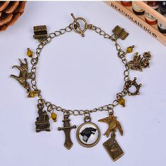 Vintage style charm bracelet inspired by Game Of Thrones. Item Type: Bracelets Style: Vintage Gender: Unisex Setting Type: Tension Setting Material: Crystal Chain Type: Link Chain Length: 18cm Clasp T