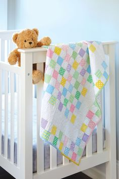 Baby quilt patterns like Baby Checks bring nostalgia back to quilting with old-fashioned charm in the fabric choices and arrangement.