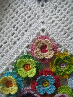 White crochet top with voluminous multi-colored flowers. Ready to ship White crochet top with voluminous multi-colored flowers. Crochet Motifs, Crochet Squares, Crochet Stitches, Crochet Patterns, Pull Crochet, Crochet Poncho, Crochet Blouse, Crochet Style, Illustration Blume