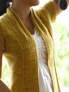 This is such a simply lovely cardigan. All the more amazing when you realize she made this from a _scarf_ pattern!