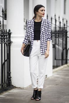 Anisa Sojka wearing black and white checked Missguided blazer, black Missguided crop top, white Missguided cigarette trousers, black Chanel caviar quilted bag and black peep toe block heel croc Missguided boots. Street style shot in London by Cristiana Malcica.