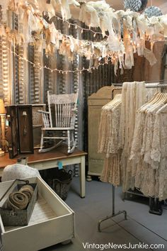 Shabby Chic Show Display. Lace jackets in the style of long jean jackets.