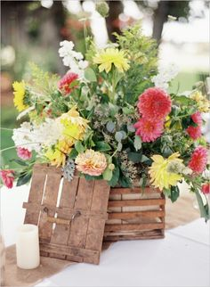 rustic floral table centerpiece #farmwedding #oregonwedding #weddingchicks http://www.weddingchicks.com/2014/01/13/summertime-country-wedding/