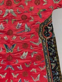 Woman's informal robe with butterflies, Qing dynasty (1644–1911), late 19th–early 20th century  China  Embroidered silk satin    Overall 53 x 82 in. (134.6 x 208.3 cm)  Gift of Mr. and Mrs. George F. Miller, 1970 (1970.145)