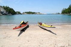 ONTARIO | Kayaks on a sandy beach in Lake Superior Provincial Park, Ontario