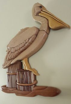 https://www.etsy.com/listing/176826354/wood-intarsia-pelican-wall-hanging