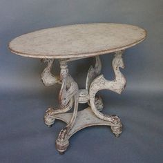 Swedish table with stylized griffons supporting the oval top, circa 1850. This is an example of the Swedish way of adopting and simplifying French forms.