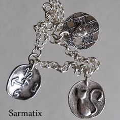 Handmade silver bracelet. Charms are made from recycled silver. OOAK.