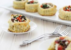 Puff Pastry Shells filled with Kalamata Olives, Spinach, Red Bell Pepper, Oregano, and Feta. A perfect appetizer for your dinner party or holiday spread!