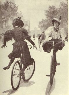 Circa 1890s photo of two acrobatic ladies having fun on their bicycles.