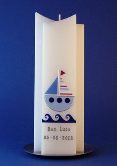 http://de.dawanda.com/product/39913526-Taufkerze-Segelboot-blau-Zweispitz-Form