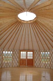 We love the wide open space you get in a Yurt! Highland Heights Yurts will have similar double doors