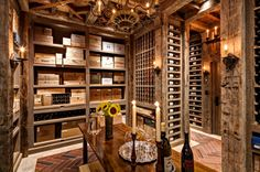 Raise A Glass! The house is grand, but a cozy wine cellar provides an intimate hideaway with a rustic feel. Reclaimed white oak, a floor of limestone and brick, and candle-like lighting lend an old-world sensibility. Another serious collector's move — there is ample storage for crates. Right up my alley