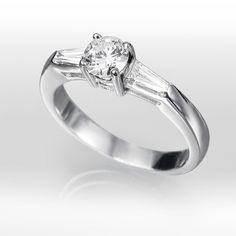 Anillo solitario de diamantes COPAL Anillo solitario con diamante central  talla brillante engastado en una montura de oro blanco de 18 kilates o  platino ... 78ae761e96