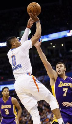 Oklahoma City's Russell Westbrook (0) shoots over Los Angeles' Larry Nance Jr. (7) during an NBA basketball game between the Oklahoma City Thunder and the Los Angeles Lakers at Chesapeake Energy Arena in Oklahoma City, Saturday, Dec. 19, 2015. Photo by Nate Billings, The Oklahoman