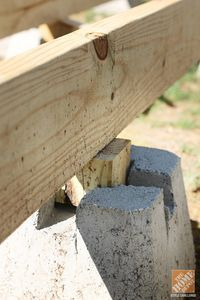 A 2x joist fits into a slot molded in the top of this dek Floating deck cinder blocks