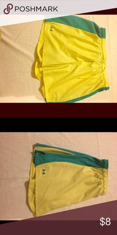 Under Armour women's yellow athletic shorts Gently used UA yellow athletic shorts size medium Under Armour Shorts
