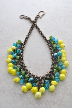 A Trendy Fringe Necklace of Yellow Vintage Glass Flowers layered with Teal and Green Faceted Czech Glass Beads