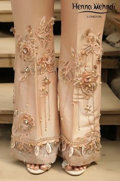 Peach raw silk boot cut trousers with embroidery and crystal hangings with embellishment. Available to order as boot cut or straight trousers. Please note delivery time is approximately weeks. There is no exchange or refund on this product as this Pakistani Bridal Dresses, Pakistani Dress Design, Pakistani Outfits, Pakistani Fashion Casual, Sleeves Designs For Dresses, Trouser Pants, Plazzo Pants, Salwar Pants, Straight Trousers
