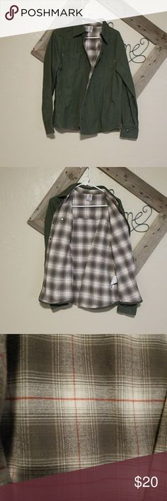 Women's Large button down Carhartt Carhartt button down. Its the typical thicker carhartt material. Pretty sage green color with green plaid flannel lining through out the entire shirt. The buttons are metal snap. There are two pockets on the front.  Very warm shirt.  I have two of these shirts the exact same the other ones a brown color with lavender and pink lining. This listing is for the green shirt only. Id be more then happy to bundle for a discount! Carhartt Tops Button Down Shirts